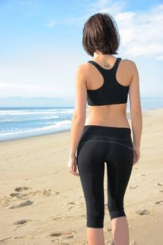 Our essential fitted crop legging is the pant you will want to live in all summer long! Made from our signature smooth support jersey, it is highly breathable & perfect for your active lifestyle. Self flat waistband & flat stitching, back yoke seam, & tonal logo embroidery on back waistband. Fitted.   Material: 60%Organically Grown Bamboo/26% Certified Organic Cotton/14% Spandex LiveBreatheYoga.com women yoga clothes