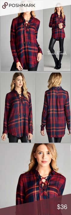 Plaid Lace Up Blouse Gorgeous colors of wine & navy plaid blouse. Featuring the hottest trend of the season lace V neck detail. Made of rayon. Size S, M, L Threads & Trends Tops Blouses