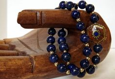 Simply Charming:  Two Stretch Beautiful Lapis Bracelets with Charm!    Tibetan Handmade Coral & Lapis Reversible Brass Charm from Nepal with 8mm Lapis Rounds and 14k Gold Filled Spacer Seamless Balls.