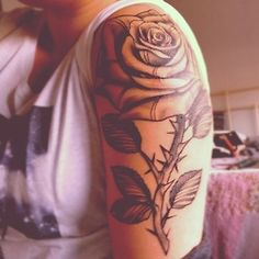 I want something like this on my upper arm! I love rose tattoos :3