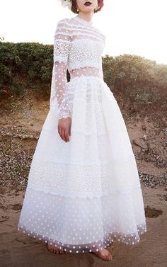 Costarellos gown features alternating panels of lace and dotted Swiss with long sleeves, a full A-line skirt