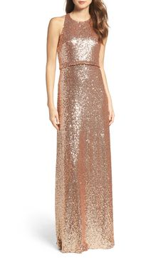 Swooning over this rose gold sequin gown that will look stunning on the maid of honor.