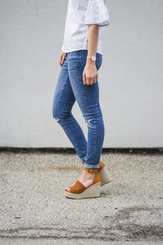 white ruffle sleeve + distressed denim. ripped jeans, white ruffle top, tan espadrille wedges, brown tan espadrilles, steve madden wedges, Marc Fisher sandals, Chloe wedges, Cute Spring Outfits, ruffle top