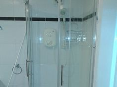 Fitted shower - Tiles - http://www.hammersnspanners.com/bathroom-fitter-glasgow.html