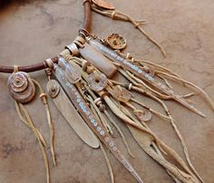 :: This necklace has been Reserved for a special customer ::  :: The Light of Solstice Noon ::  This elaborate choker assemblage that celebrates the beginning of summer began with two cast resin spikes. Originally meant to be earrings, they turned out a bit long so I decided to use them as pendants. They were cast from dried Joshua tree spikes I found in the Mojave Desert of California. I arranged a line of tiny iridescent shell heishe beads in the molds, laid in sterling silver wires, added…