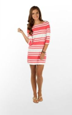 You will look effortlessly gorgeous as you skip off to class in this boatneck dress.