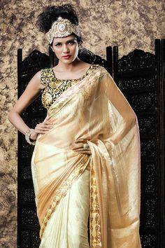 Cream and white Georgette Saree With Satin Blouse Cream and white georgette saree with black satin blouse.  Embellished with embroidered and zari.  Saree comes with square neck blouse.  Product are available in 34,36,38,40 sizes. It is perfect for casual wear, festival wear, party wear and wedding wear. http://www.andaazfashion.com.my/womens/sarees/georgette