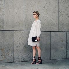 50 Inspiring Street Style Outfits To Try For Summer via @Who What Wear- Love the soft white dress with the hard black heels