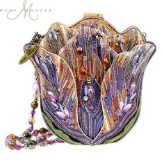 "Mary Frances Tempting Tulip Flower Extensively Hand Beaded Bejeweled Handbag Shoulder Bag Tempting Tulip Handbag With an amazing combination of bright purples, oranges, and greens, Mary Frances' ""Tempting Tulip"" handbag is simply the must have bag of the Unique Handbags, Unique Bags, Purses And Handbags, Vintage Purses, Vintage Bags, Vintage Handbags, Mary Frances Purses, Mary Frances Handbags, Beaded Purses"