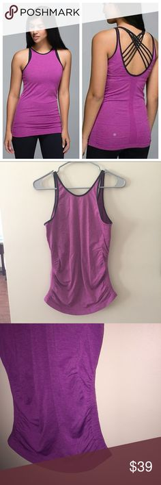 """Lululemon In The Flow Purple Tank Bust: 16.5"""" across laying flat Length from top of shoulder to bottom of hem: 27.5"""" Beautiful purple color, excellent condition, size tag has been ripped off, no size dot can be found, the placement and coloration of the lululemon emblem logo on back of this tank design shows 100% authenticity. Breathable material with meshed venting. Scooped back. Sweat wicking. Black Trim along neckline. Chafe resistant. lululemon athletica Tops Tank Tops"""