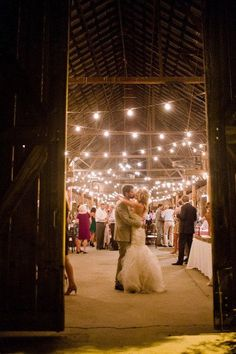 Dancing the night away- rustic barn wedding with twinkle lights