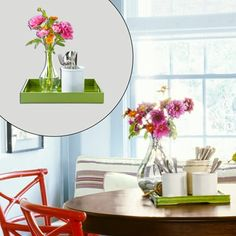 Fresh-cut blooms on a grass-green serving tray are sure to set the spring vibe for a delicious weekend brunch.