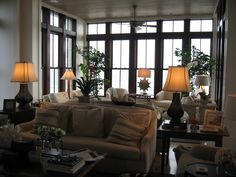 Love all the windows and dark wood trim.