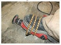 Yes that tool will cut through concrete and rebar, but your rubber sole boots should be fine.
