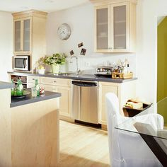 Bright light galley kitchen - grey countertops are nice
