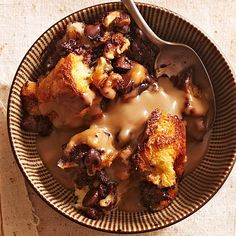 Yum! Enjoy this chocolate-walnut bread pudding recipe with a hot cup of coffee or a cold glass of milk. This easy dessert is topped with a coffee-Kahlua cream sauce.