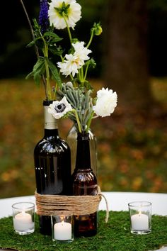 Large Round Table Alternative-- trio of dark beer/wine bottles (this shows them banded together with twine but they could be loose as well) and each one would have a different flower mix using wedding flowers/colors