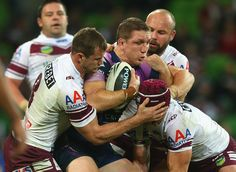 Ryan Hoffman of the Storm is tackled during the round 10 NRL match between the Melbourne Storm and the Manly Sea Eagles at AAMI Park on May 20, 2013 in Melbourne, Australia.