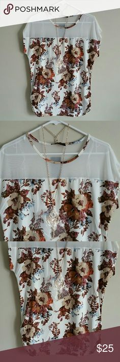 New never worn Beautiful Tops With Necklace. Brand new top with necklace, new never worn.  Size Medium.  Length 27.5 in Bust  40 in 95% Polyester.  5% Spandex.  Smoke and pet free home.  Fast shipping + Extra gift. Lowest. Tops Blouses