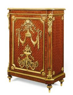 A FRENCH GILT-BRONZE MOUNTED KINGWOOD AND BOIS SATINÉ PARQUETRY CABINET, CIRCA 1900 with a white marble top above door mounted with baldachin above flower arrangement, the door opening to two shelves, bearing a 'F. Linke' stamp