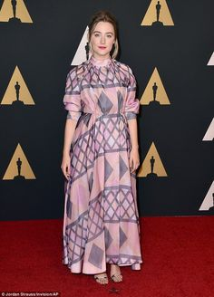 Indy frock: Saoirse Ronan also broke from the usual black tie event style, walking down th...