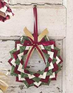 This pretty ornament is made from folded squares of fabric pinned to a Styrofoam form. Easy! Get the pattern here (click and scroll to the link in the yellow box): http://quiltingdigest.com/starry-night-ornament-is-super-quick-and-easy/
