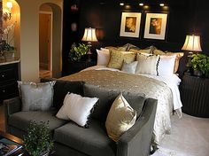 "Love the ""Love Seat"" at the end of the bed and the light gold on the black walls!"