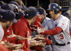 St. Louis #Cardinals' Carlos Beltran is congratulated in the dugout after hitting a two-run HR during the fourth inning of Game 1.