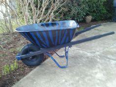Zebra painted wheelbarrow makes pulling weeds fun !