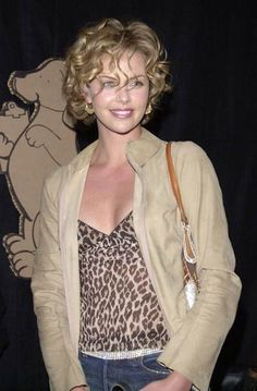 Charlize with short, naturally curly hair.