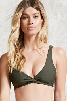 5b582277fc A stretch-knit bralette bikini top featuring a twisted front with cutouts