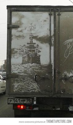 "An awesome example of ""Dirty Car Art"".  This piece of art was created by artfully removing dirt & sludge from the back of a filthy delivery truck creating negative space to make the wonderful nautical image.  Unfortunately, the artist was not noted."
