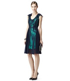 Sheer Overlay Emerald Sequin Dress (Reiss, $370.00) - blue sheer chiffon, emerald green sequins, fitted top, flowy sleeves, flares at waist, pleated, classy.