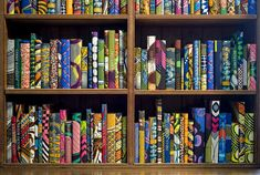 """A new installation by the British artist Yinka Shonibare celebrates the cultural contributions of immigrants through a medium we can never get enough of: brightly-colored books. Installed in the library of the Brighton Museum and Art Gallery near England's southern coast, Shonibare's show, titled """"The British Library"""", comprises 10,000 hardcover books which have been covered in colorful African Dutch batik fabric."""