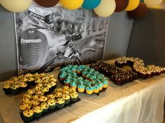 Cupcake Table | How to Throw the Perfect Graduation Celebration | http://www.hercampus.com/diy/parties-gifts/how-throw-perfect-graduation-celebration-0