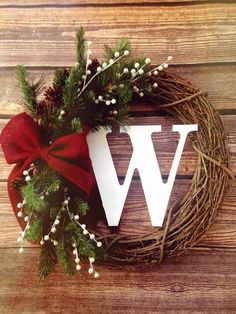 Holiday Rustic Grapevine Wreath with garland, pearls and a beautiful burlap bow! Holidays. Seasonal. Christmas. Winter. on Etsy, $46.00