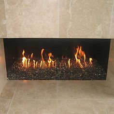 We will be updating our fireplace to use glass rocks rather than logs. Our outdoor gas firepit that we installed will have the glass rocks also.
