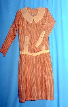 Dress ca 1926  A day dress of red rayon taffeta, patterned with closely spaced beige spots.