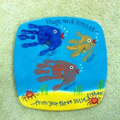 gift idea for dad.  Kids' handprint fish & mom's thumb for the crabs.