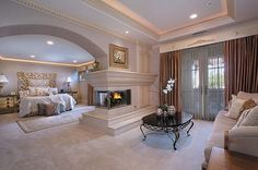 Master Bedroom - love the fireplace, arch, and tray ceiling