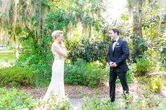 First Look Near Carriage House | Rustic Pastel Wedding at Magnolia Plantation by Charleston wedding photographer Dana Cubbage