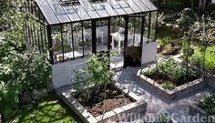 Greenhouse breezeway opening into garden