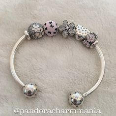 Pandora bracelet open bangle with spring charms, butterflies and sparkling daisies