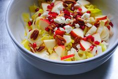 Endive salad with apple, pomegranate, pecans and goat cheese  Another great winter salad: endives, celery, apple, toasted pecans, pomegranate seeds and goat cheese with a Galeo dressing.