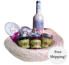 Beachcomber Jams by Mississippi Mermaid include jars of gourmet jelly in Caribbean Jam, Muscadine grape, and strawberry, A decorative ceramic spoon holder, A hand painted designer bottle, Fridge magnet and a variety bag of seashells all inside a large beach hat.