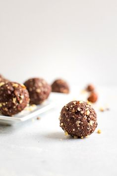 Homemade chocolate hazelnut energy bites made with only six real food ingredients. They taste like Ferrero Rocher candies but are healthy, gluten-free and vegan. #vegan #glutenfree #energybites