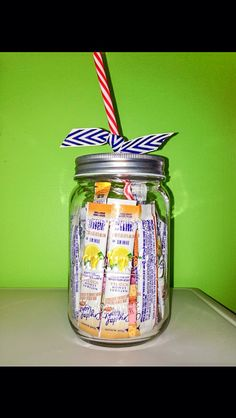 Birthday gift idea: mason jar drinking glass filled with drink mix, candy, and gift card
