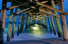 I spent every summer growing up at Emerald Isle at my grandparents' beach house. I spent so much time on, around and under this pier. Breaks my heart that it was damaged by Hurricane Irene.