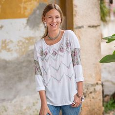 """MERRIWEATHER TOP--So sweet and elegant, a lushly embroidered woven front and sleeves, with raw-edge and cutout details. Slub back, three-quarter sleeves. Cotton. Machine wash. Imported. Exclusive. Sizes XS (2), S (4 to 6), M (8 to 10), L (12 to 14), XL (16). Approx. 27""""L."""