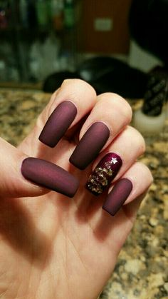 Burgundy matte with a gold Christmas tree nails